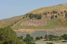 logo shows on the hillside la cofradia distillery