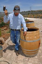 A worker prepares a French white oak barrel at tres mujeres tequila distillery - 2010